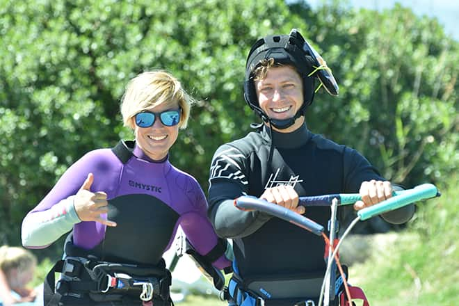 People taking kitesurf intermediate lesson in Sicily at lo Stagnone lagoon with flow kite school.